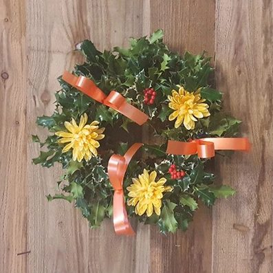 Yellow and orange holly wreath